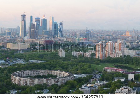 panoramic view of Moscow sity business complex with skyscrapers, river, park and trees  - stock photo