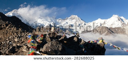 Panoramic view of  mount Cho Oyu and mount Gyachung Kang with prayer flags from Gokyo Ri, way to Cho Oyu base camp, Gokyo valley, Sagarmatha national park, Khumbu valley, Everest area, Nepal - stock photo
