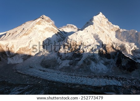 Panoramic view of Mount Everest, Lhotse and Nuptse from Pumo Ri base camp - way to Mount Everest base camp Sagarmatha national park - Nepal  - stock photo