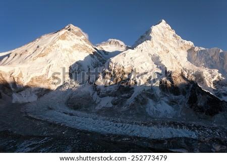 Panoramic view of Mount Everest, Lhotse and Nuptse from Pumo Ri base camp - way to Mount Everest base camp Sagarmatha national park - Nepal  - stock photo