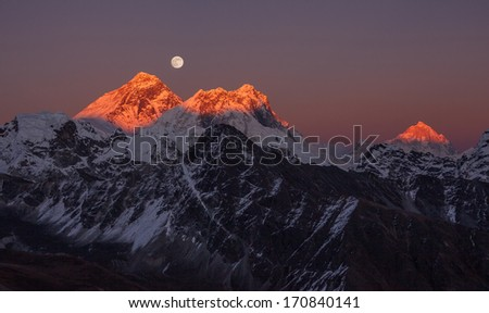 Panoramic view of Mount Everest (8848 m) and Makalu peak (8485 m) at sunset on a full moon. Canon 5D MK II. - stock photo
