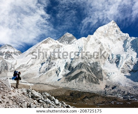 panoramic view of Mount Everest with beautiful sky, tourist and Khumbu Glacier from Kala Patthar - Khumbu valley - Nepal  - stock photo