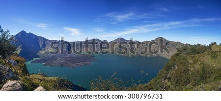 Panoramic view of Mount Rinjani, volcano Barujani and Lake Segara Anak in Lombok Island, Indonesia. - stock photo