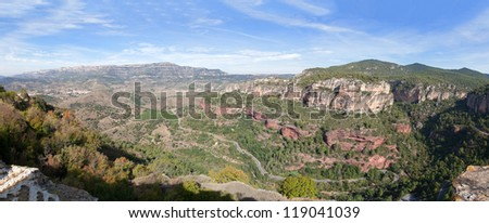 Panoramic view of mountain canyon with road