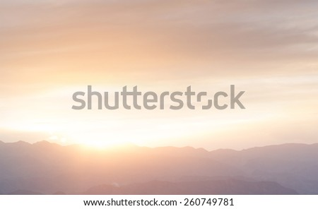 panoramic view of mountain outline  during sunset - stock photo