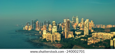 Panoramic view of Mumbai's afluent Napean Sea area with Arabian sea at sunset in a warm glow. Here most of super rich billionaires and millionaires stay in high-rise towers. Copy space. - stock photo