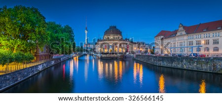 Panoramic view of Museumsinsel (Museum Island) with famous TV tower and Spree river in twilight during blue hour at dusk, Berlin, Germany - stock photo