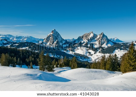 panoramic view of mythen mountains in winter, switzerland