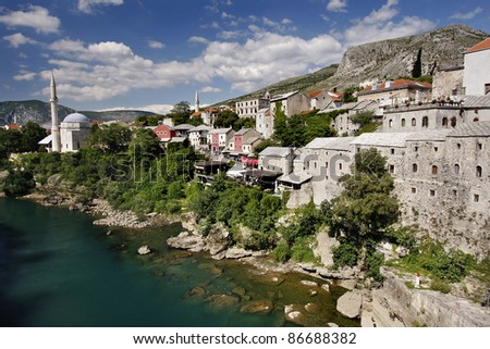 Panoramic view of Neretva river and old cobbled street Kujundziluk, from The Old Bridge in Mostar, Bosnia and Herzegovina - stock photo
