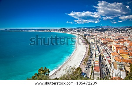 Panoramic view of Nice coastline and beach with blue sky, France. - stock photo