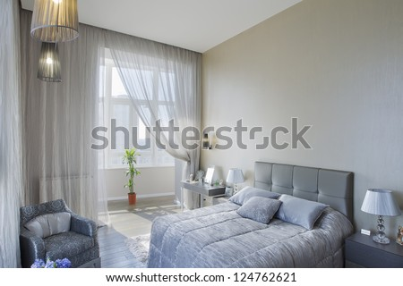 panoramic view of nice cozy bedroom - stock photo