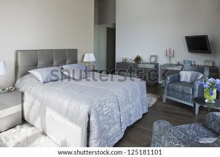 panoramic view of nice cozy bedroom - stock photo
