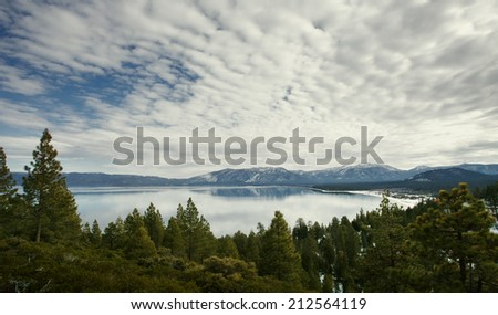 Panoramic view of nice forest, lake with mountain on the back - stock photo