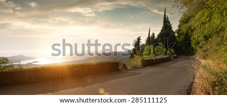 panoramic  view of nice summer empty road  through the mountain - stock photo