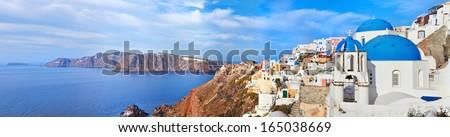 Panoramic view of Oia village on Santorini island, Greece. - stock photo