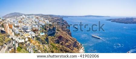 Panoramic view of Oia village on Santorini island, Greece - stock photo