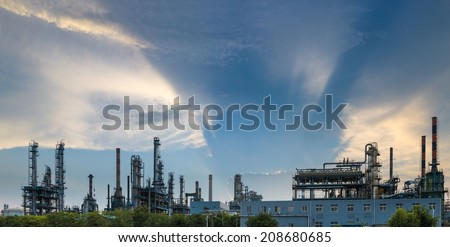 panoramic view of oil refinery with a dramatic sky at  twilight  - stock photo