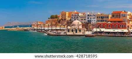 Panoramic view of old harbour of Chania with Venetian quay and Kucuk Hasan Pasha Mosque, Crete, Greece