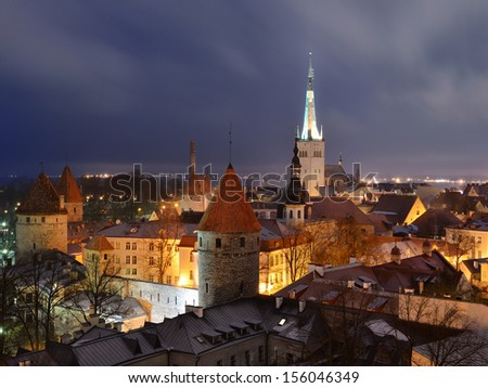 Panoramic view of old part of Tallin by night - stock photo