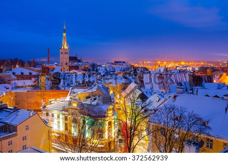 Panoramic view of old part of Tallinn in winter. Oleviste and old harbor - stock photo