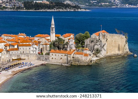 Panoramic view of Old town Budva: Ancient walls and red tiled roof. Montenegro, Europe. Budva - one of best preserved medieval cities in the Mediterranean and most popular resorts of Adriatic Riviera. - stock photo
