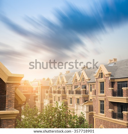 Panoramic view of old town in Europe in beautiful evening light at sunset with retro vintage Instagram style grunge filter and lens flare effect - stock photo