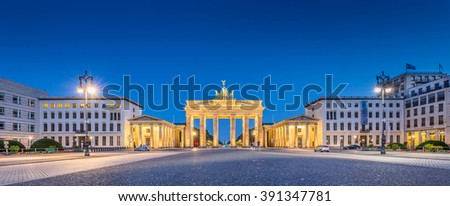 Panoramic view of Pariser Platz with famous Brandenburger Tor (Brandenburg Gate), one of the best-known landmarks and national symbols of Germany, in twilight during blue hour at dawn, Berlin, Germany - stock photo
