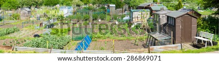 Panoramic view of Plots of land cultivated by the tenants for food production - stock photo