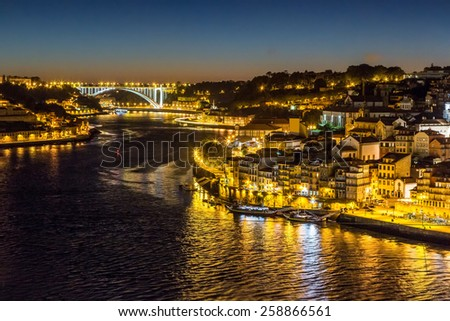 Panoramic view of Porto in Portugal at night - stock photo