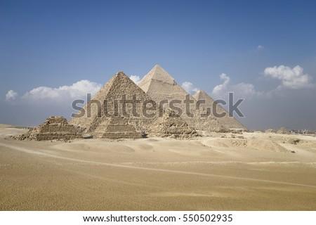 Panoramic view of pyramids from the Giza Plateau (three pyramids known as Queens' Pyramids on front side; next in order from left: the Pyramid of Menkaure, Khafre and Chufu, Cairo, Egypt