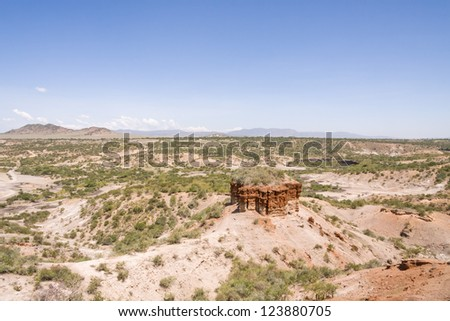 Panoramic view of ravine Olduvai Gorge, one of the most important paleoanthropological sites in the world - the Cradle of Mankind. Great Rift Valley, Tanzania, Eastern Africa.