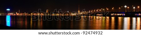 Panoramic view of Riga by night - stock photo