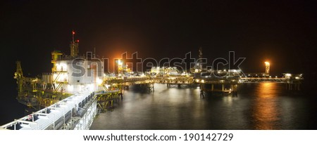 Panoramic view of rigs in a large oil-field - stock photo