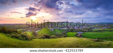 Panoramic View of Ruins of the Corfe castle at sunrise in Dorset, Uk. - stock photo