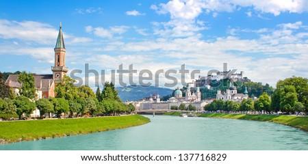 Panoramic view of Salzburg skyline with Festung Hohensalzburg and river Salzach, Salzburger Land, Austria - stock photo