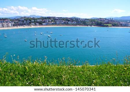 Panoramic view of San Sebastian on a sunny day - stock photo