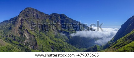 Panoramic view of Sangkareang mountain at Rinjani mountain, Lombok island, Indonesia with clouds moving in.