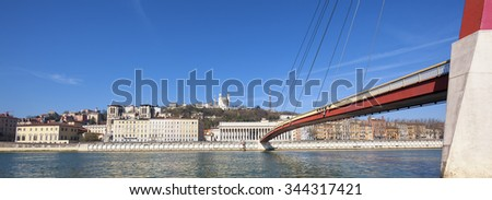Panoramic view of Saone river at Lyon with red footbridge, France, Europe. - stock photo