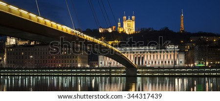 Panoramic view of Saone river by night, Lyon. - stock photo
