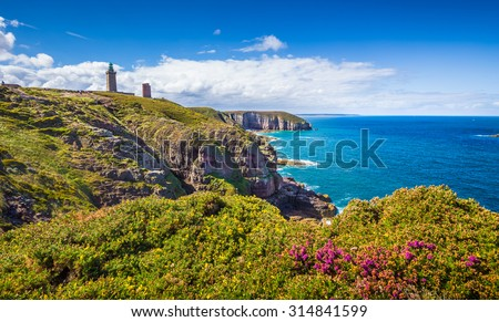 Panoramic view of scenic coastal landscape with traditional lighthouse at famous Cap Frehel peninsula, Bretagne, northern France - stock photo
