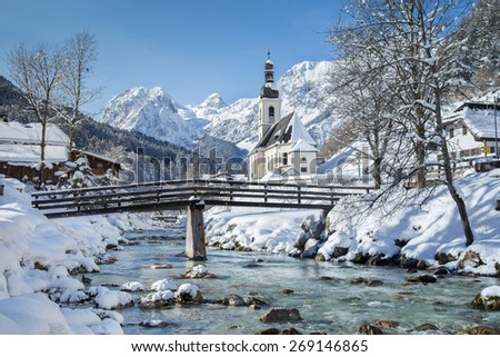 Panoramic view of scenic winter landscape in the Bavarian Alps with famous Parish Church of St. Sebastian in the village of Ramsau, Nationalpark Berchtesgadener Land, Upper Bavaria, Germany - stock photo