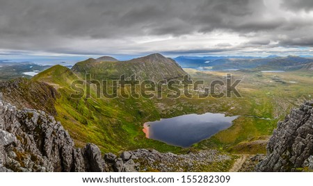 Panoramic view of Scottish highlands, mountains in Loch Assynt area, United Kingdom - stock photo