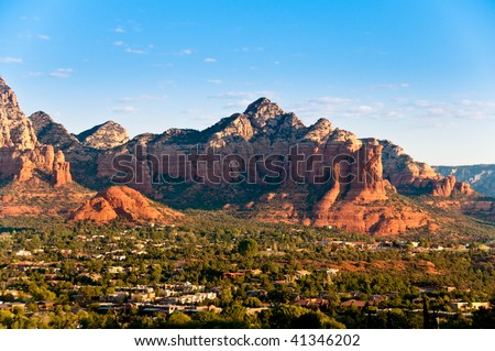 Panoramic view of Sedona surrounded by the red stone mountains