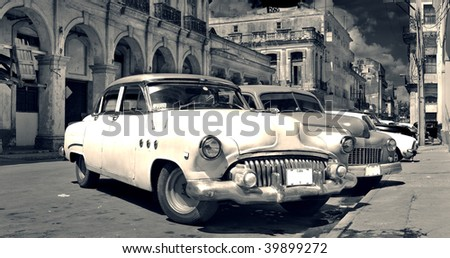 Panoramic view of shabby old havana street with vintage classic american cars - stock photo