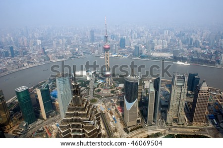 panoramic view of shanghai in China,  overlook pudong, huangpu river, puxi, jinmao tower and the oriental pearl Tower. - stock photo