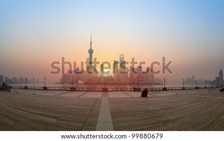 panoramic view of shanghai skyline at sunrise from the bund - stock photo
