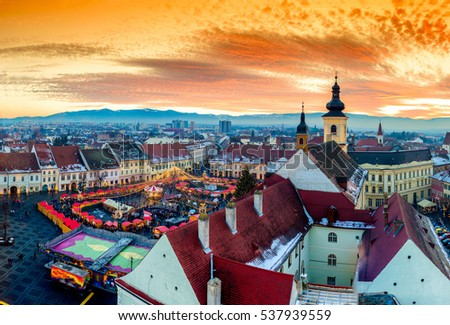 Panoramic view of Sibiu central square in Transylvania, Romania. City also known as Hermannstadt. Sunset HDR hi-resolution photography.