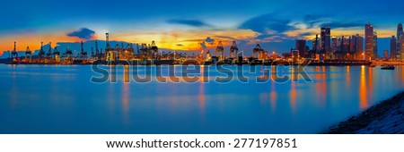 Panoramic view of Singapore container port at sunset - stock photo