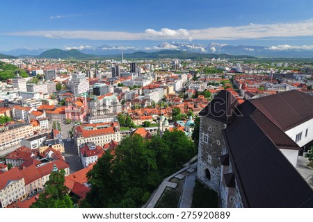 Panoramic view of Slovenian capital Ljubljana and Ljubljanas castle in the foreground - stock photo