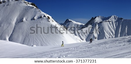Panoramic view of snowboarders downhill on off piste slope after snowfall. Caucasus Mountains, Georgia, region Gudauri. - stock photo